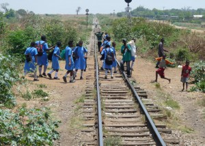 Mazabuka: School children on railroad tracks near Mazabuka station